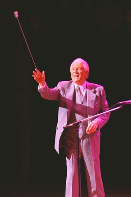 Tommy possing his bow into the audence before leaving stage.