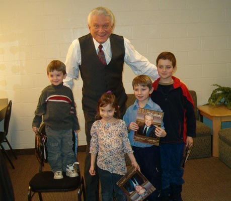 Tommy posing with his counsin's four children: Tyler, Shanelle, Dylan and Michael.