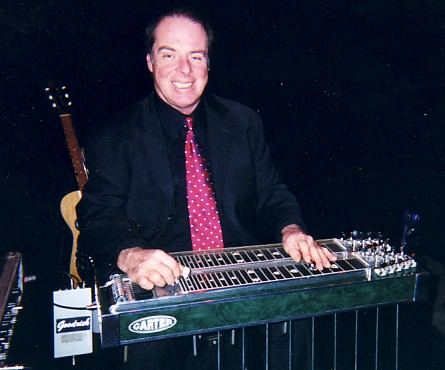 Steve Smith posing with his steel guitar.