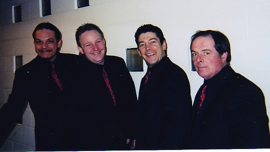 Tommy Hunter's band, The Travelin' Men, pose.