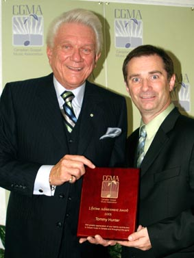 Tommy receiving his lifetime achievement award in 2005 from Martin Smith.