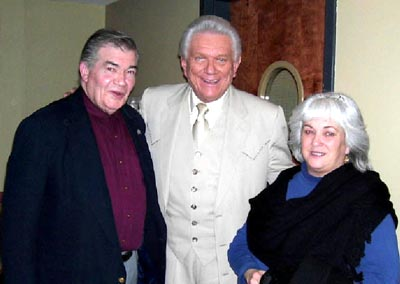 Tommy, Gerry and Carol Taylor, posing.