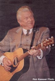 old photo of tommy hunter paying guitar