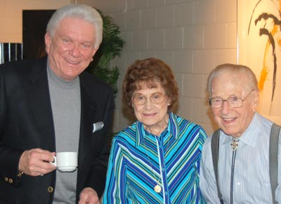 Tommy, Kitty Wells & Johnny Wright posing.