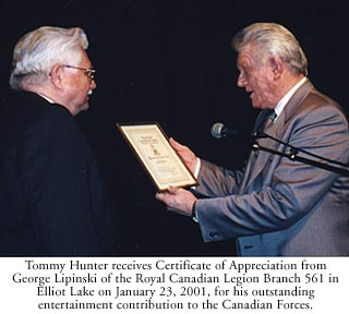 Tommy Hunter recieving and award from the canadian legion.