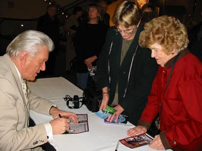 Tommy signing autographs for fans after a show.