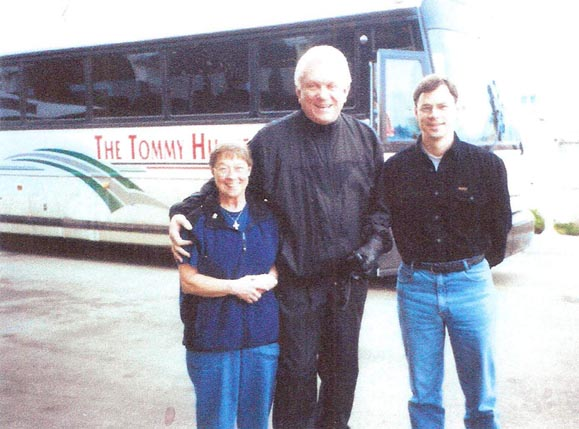 Tommy, Sandra, and Clint in Kamloops BC 2001 posing in front of Tommy's tour bus